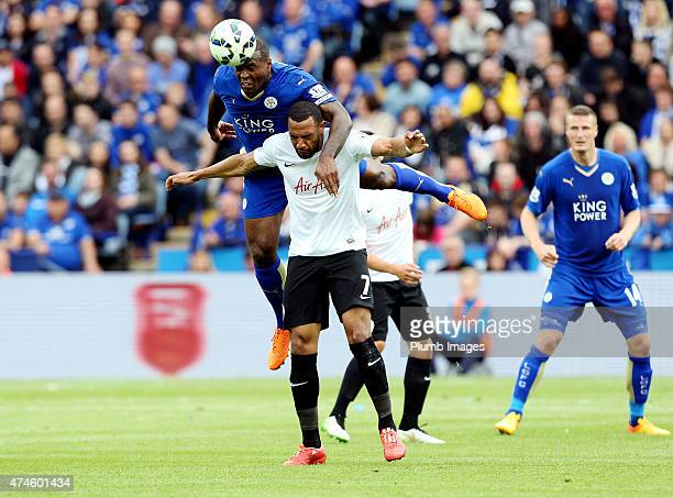 Wes Morgan of Leicester City in action with Matt Phillips of QPR during the Barclays Premier League match between Leicester City and Queens Park...