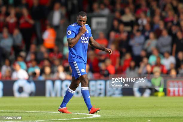 Wes Morgan of Leicester City leaves the pitch following receiving a red card during the Premier League match between AFC Bournemouth and Leicester...