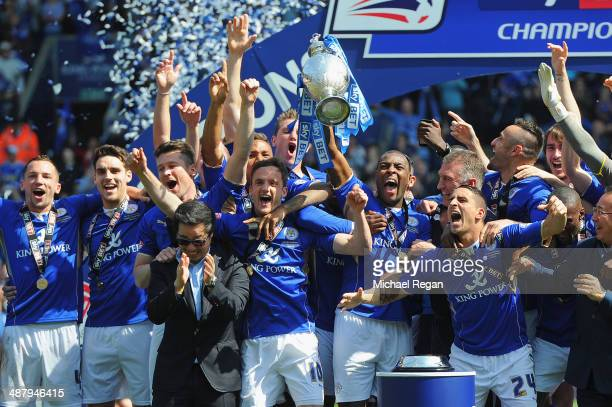 Wes Morgan of Leicester City lifts the Championship trophy after the Sky Bet Championship match between Leicester City and Doncaster Rovers at The...