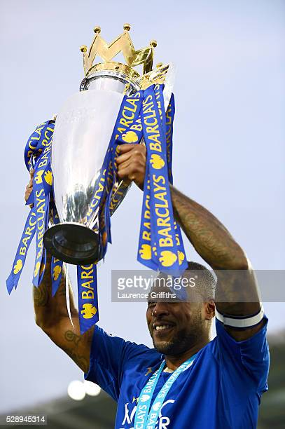 Wes Morgan of Leicester City lifts the Premier League Trophy as players and staffs celebrate the season champions after the Barclays Premier League...