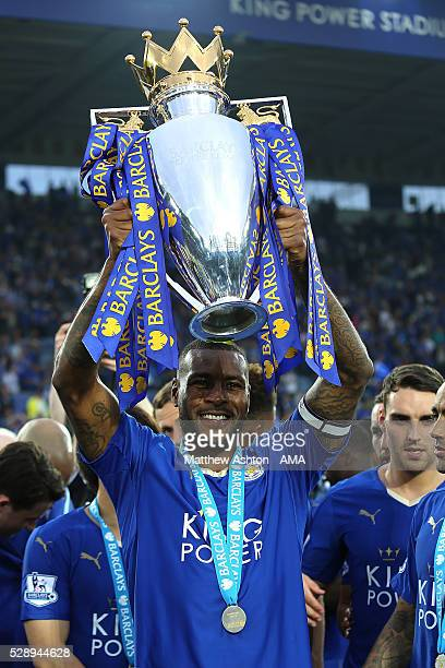 Wes Morgan of Leicester City lifts the Premier League Trophy as Leicester City celebrate becoming Premier League Champions for the 2015/16 Season at...