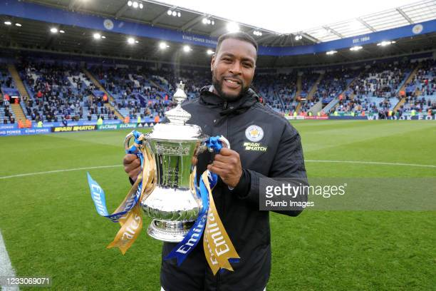 Wes Morgan of Leicester City poses with the FA Cup trophy after the Premier League match between Leicester City and Tottenham Hotspur at The King...