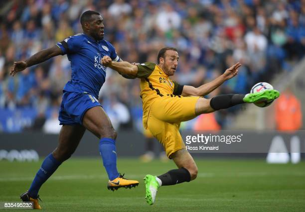 Wes Morgan of Leicester City puts pressure on Glenn Murray of Brighton and Hove Albion during the Premier League match between Leicester City and...