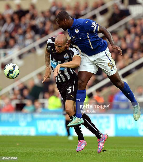 Wes Morgan of Leicester City rises above Gabriel Obertan of Newcastle United to win a header during the Barclays Premier League match between...