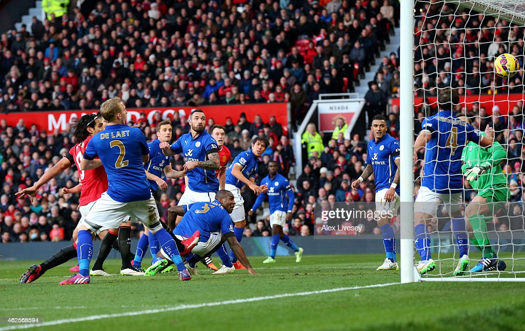 Wes Morgan #5 of Leicester City scores an own goal to give Manchester United a 3-0 first half lead during the Barclays Premier League match between Manchester United and Leicester City at Old Trafford on January 31, 2015 in Manchester, England.