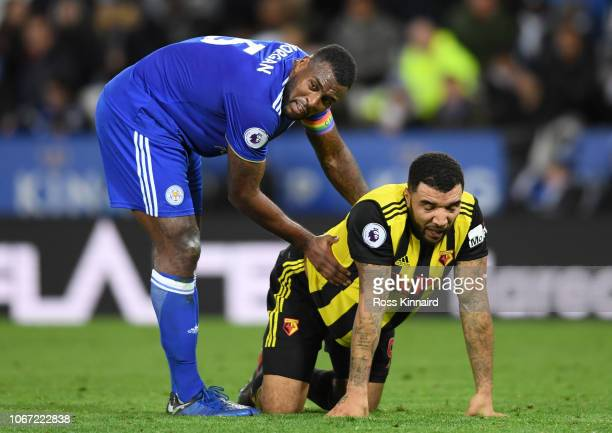 Wes Morgan of Leicester City speaks with Troy Deeney of Watford during the Premier League match between Leicester City and Watford FC at The King...