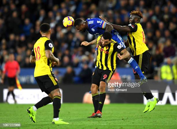 Wes Morgan of Leicester City wins a header from Troy Deeney of Watford during the Premier League match between Leicester City and Watford FC at The...