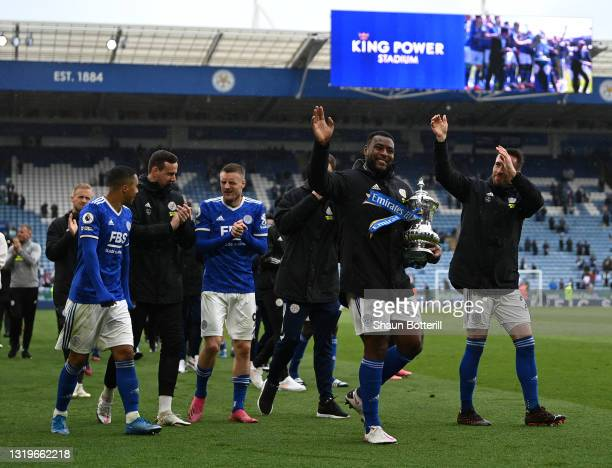 Wes Morgan of Leicester City with the FA Cup at the end of the Premier League match between Leicester City and Tottenham Hotspur at The King Power...