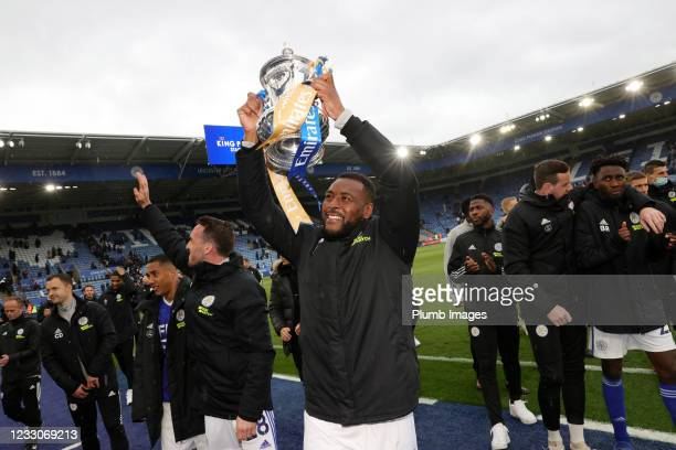Wes Morgan of Leicester City with the FA Cup trophy during a lap of the pitch after the Premier League match between Leicester City and Tottenham...
