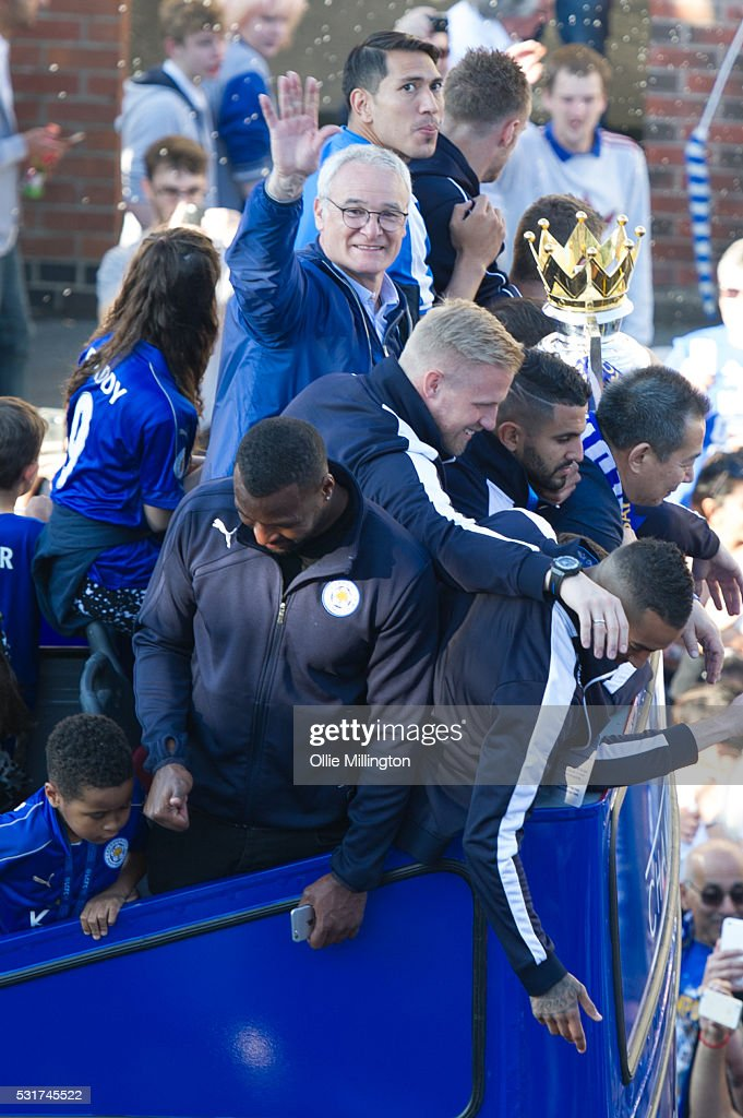 Wes Morgan, Riyad Mahrez, Kasper Schmeichel, coach Claudio Ranieri, Jamie Vardy, Andy King and Leonardo Ulloa of Leicester city on the Leicester City Barclays Premier League winners bus heading up London Road to Victoria Park during their parade on May 16, 2016 in Leicester, England.