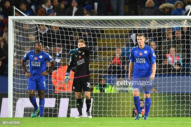 Wes Morgan RonRobert Zieler and Robert Huth of Leicester City look on after conceding their second goal during the Premier League match between...