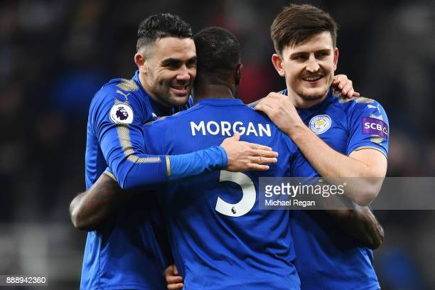 Wes Morgan Vicente Iborra and Harry Maguire of Leicester City celebrate after the Premier League match between Newcastle United and Leicester City at...