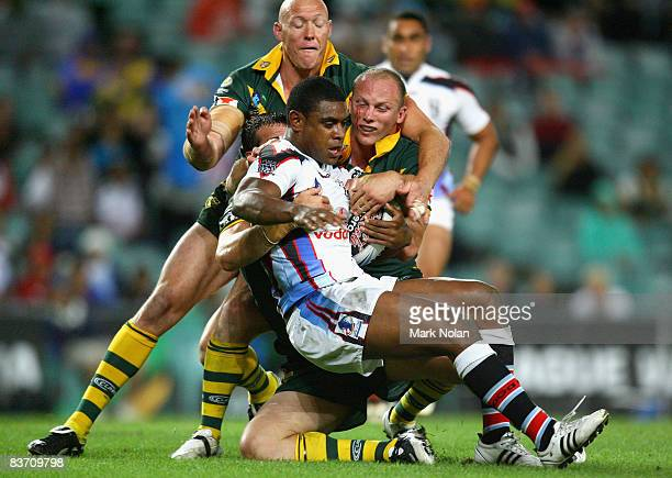 Wes Naiqama of Fiji is tackled the Kangaroos defence during the 2008 Rugby League World Cup Semi Final match between the Australian Kangaroos and...