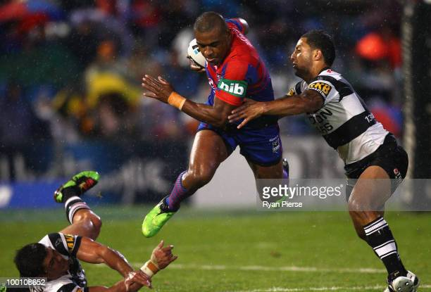 Wes Naiqama of the Knights breaks through the Tigers defense during the round 11 NRL match between the Newcastle Knights and the Wests Tigers at...