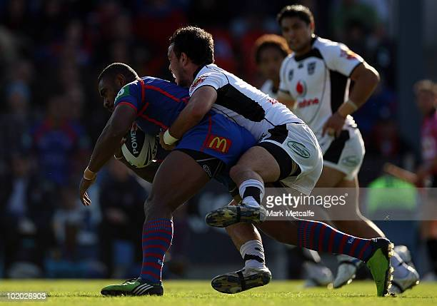 Wes Naiqama of the Knights is tackled during the round 14 NRL match between the Newcastle Knights and the Warriors at EnergyAustralia Stadium on June...