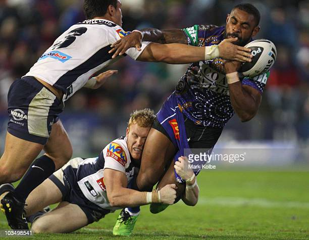Wes Naiqama of the Knights is tackled during the round 24 NRL match between the Newcastle Knights and the Brisbane Broncos at EnergyAustralia Stadium...