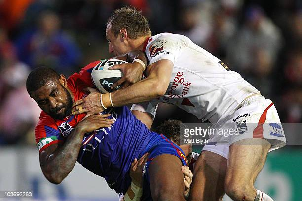 Wes Naiqama of the Knights is tackled during the round 25 NRL match between the Newcastle Knights and the St George Illawarra Dragons at...