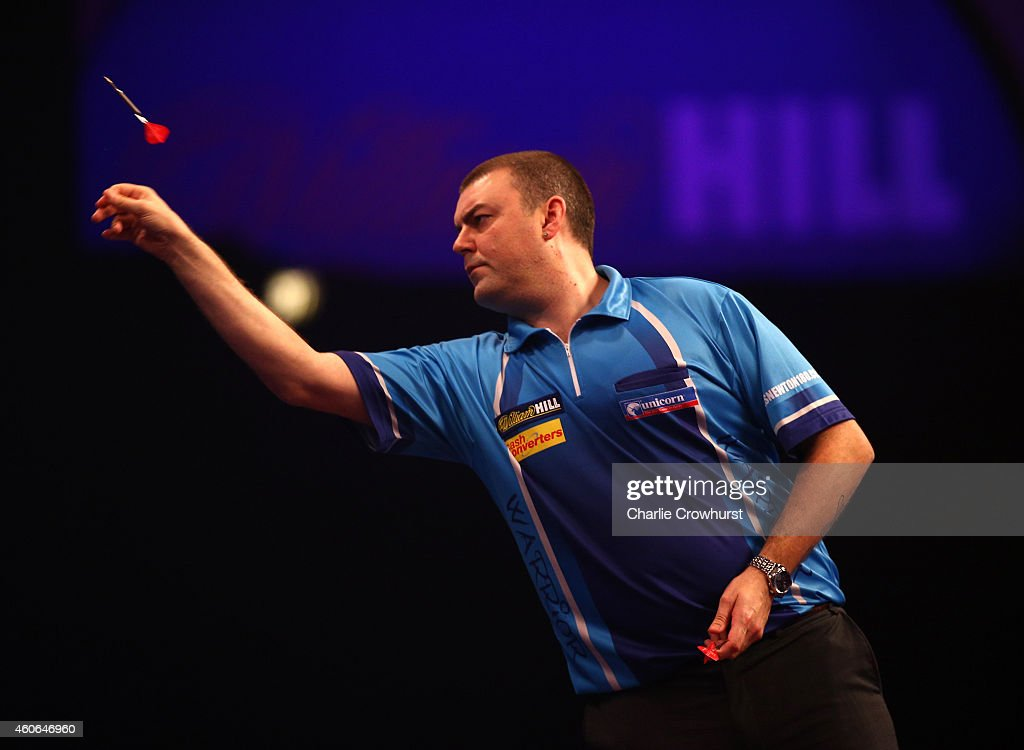 Wes Newton of England in action against during his first round match against Cristo Reyes of Spain during his first round match against Wes Newton during the William Hill PDC World Darts Championships on Day One at Alexandra Palace on December 18, 2014 in London, England.