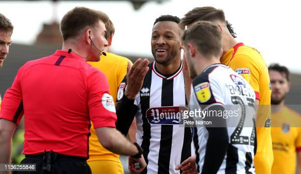 Wes Thomas of Grimsby Town makes a point to referee Ollie Yates during the Sky Bet League Two match between Grimsby Town and Northampton Town at...