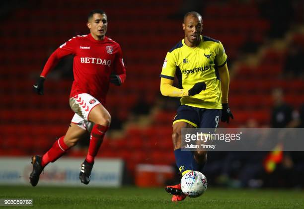 Wes Thomas of Oxford passes the ball under pressure from Ahmed Kashi of Charlton during the EFL Checkatrade Trophy Third Round match between Charlton...