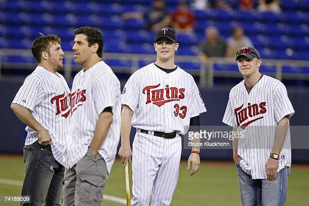 Wes Walz Keith Carney and Mark Parrish of the Minnesota Wild chat with Justin Morneau of the Minnesota Twins before a game against the Detroit Tigers...