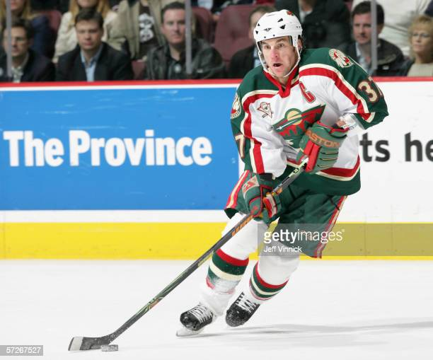 Wes Walz of the Minnesota Wild skates with the puck against the Vancouver Canucks during the game at General Motors Place on March 29 2006 in...