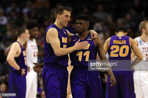 Wes Washpun of the Northern Iowa Panthers celebrates with Matt Bohannon in the second half against the Texas Longhorns during the first round of the...
