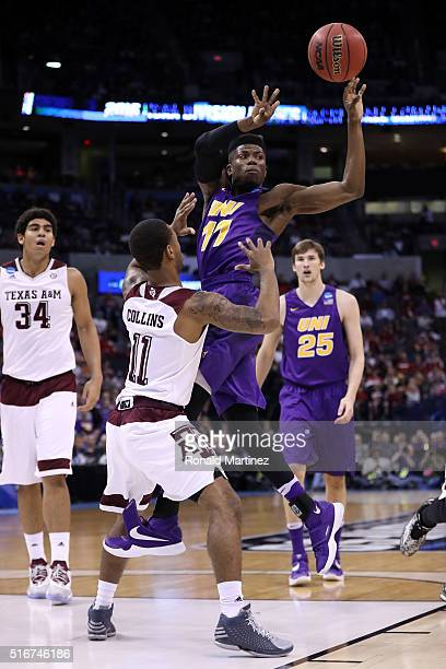 Wes Washpun of the Northern Iowa Panthers pass the ball in the first half against Anthony Collins of the Texas AM Aggies during the second round of...