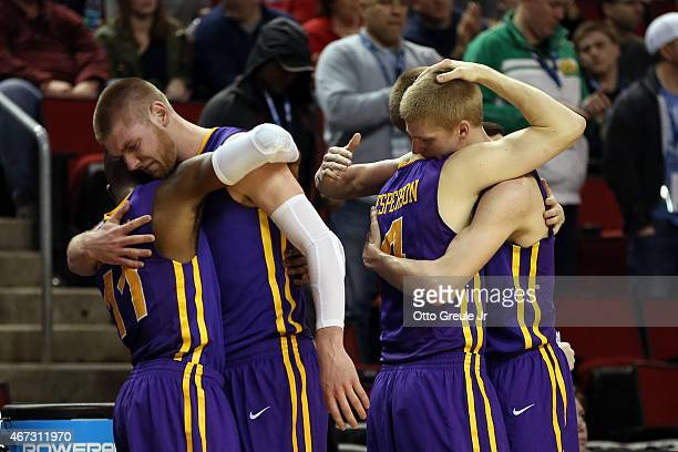 Wes Washpun Seth Tuttle Paul Jesperson and Nate Buss of the Northern Iowa Panthers react after being defeated by the Louisville Cardinals 66 to 53...