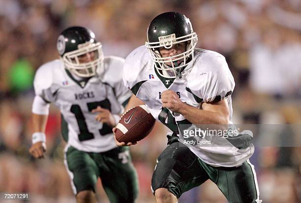Wes Weitlauf of the Trinity Shamrocks runs with the ball against the St Xavier Tigers during their regular season High School football game September...