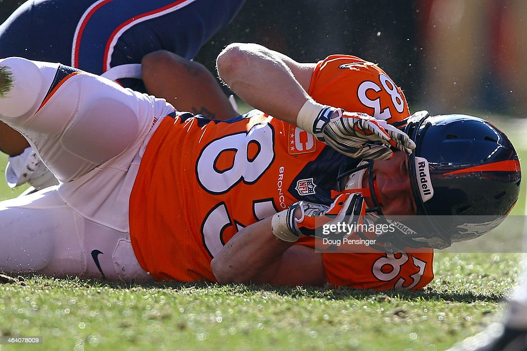 Wes Welker #83 of the Denver Broncos falls on the ground after colliding with Aqib Talib #31 of the New England Patriots during the AFC Championship game at Sports Authority Field at Mile High on January 19, 2014 in Denver, Colorado.