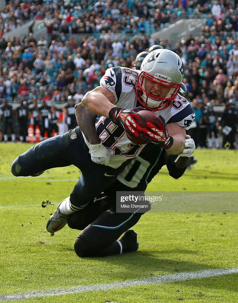 Wes Welker #83 of the New England Patriots dives for a touchdown during a game against the Jacksonville Jaguars at EverBank Field on December 23, 2012 in Jacksonville, Florida.