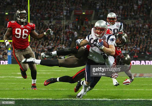 Wes Welker of the New England Patriots goes over for the second touchdown during the NFL International Series match between New England Patriots and...