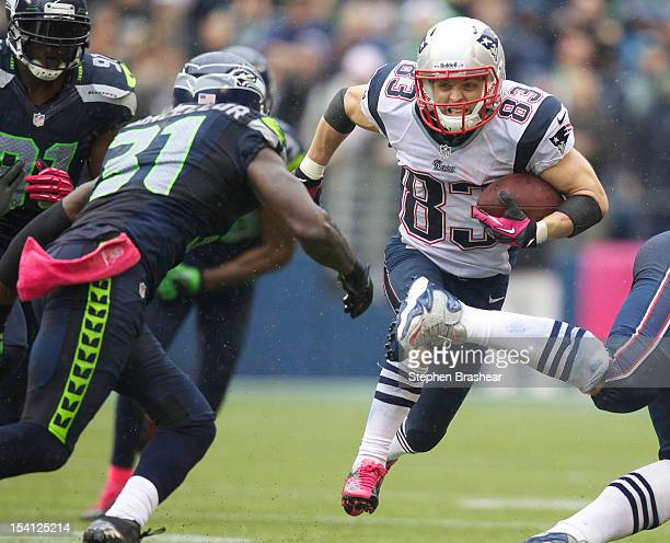 Wes Welker of the New England Patriots runs after making a reception as Kam Chancellor moves in for the tackle during a game at CenturyLink Field on...