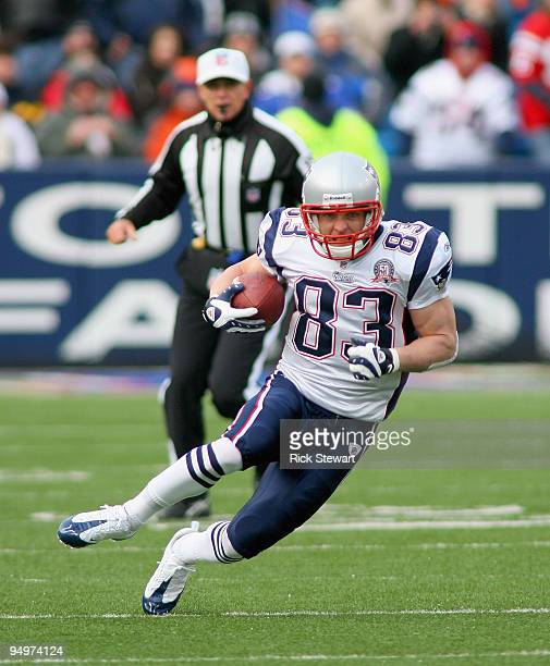 Wes Welker of the New England Patriots runs against the Buffalo Bills defends at Ralph Wilson Stadium on December 20, 2009 in Orchard Park, New York....