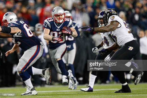 Wes Welker of the New England Patriots runs with the ball against Terrell Suggs of the Baltimore Ravens during the 2013 AFC Championship game at...