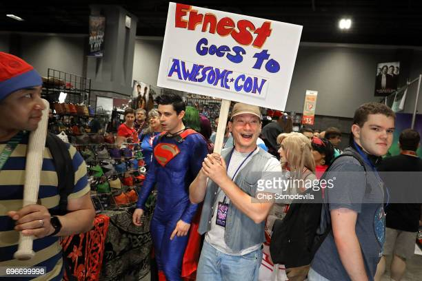 Wes Whitlock of Baltimore MD dresses as the 80s television and movie character Ernest P Worrell during the first day of Awesome Con at the Walter E...