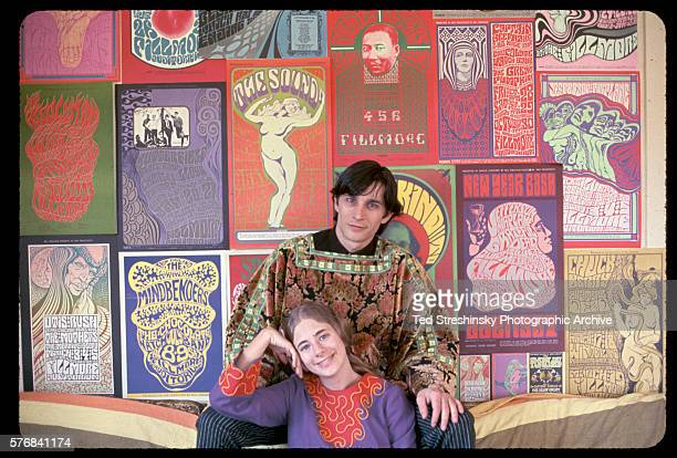 Wes Wilson and his wife pose in front of the psychedelic music concert posters which Wes became known for the 1960s San Francisco 1978