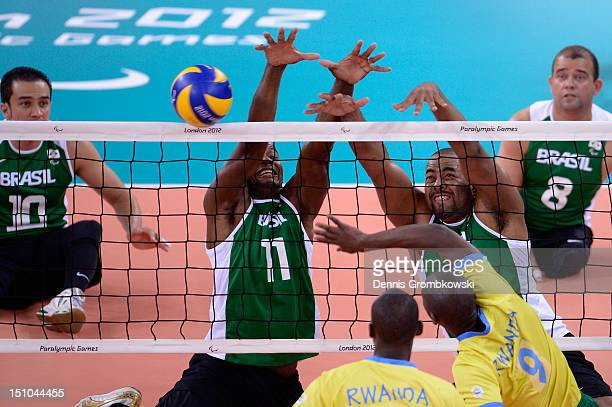 Wescley Oliveira of Brazil and teammate Wellington Platini block during the Men's Sitting Volleyball Preliminaries Pool B match between Brazil and...