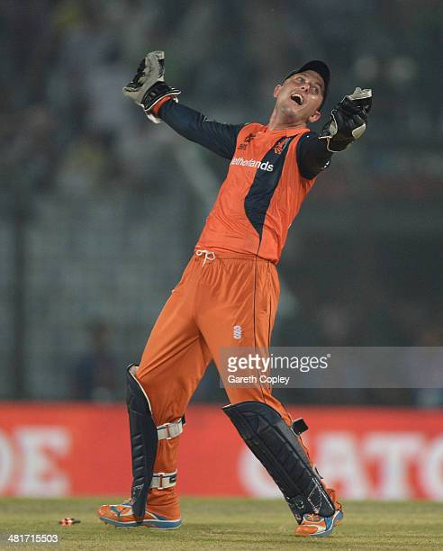 Wesley Barresi of the Netherlands celebrates running out James Tredwell of England to win the ICC World Twenty20 Bangladesh 2014 Group 1 match...