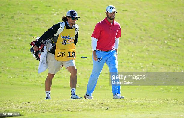 Wesley Bryan and his brother and caddie George Bryan IV walk the fairway during the final round of the Chitimacha Louisiana Open presented by NACHER...