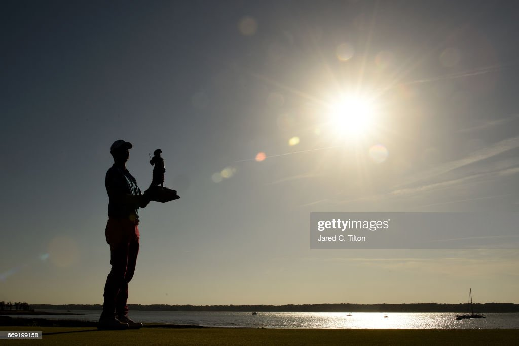 Wesley Bryan celebrates with the trophy after winning the 2017 RBC Heritage after the final round at Harbour Town Golf Links on April 16, 2017 in Hilton Head Island, South Carolina.