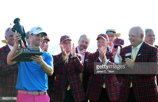 Wesley Bryan celebrates with the trophy after winning the 2017 RBC Heritage after the final round at Harbour Town Golf Links on April 16 2017 in...