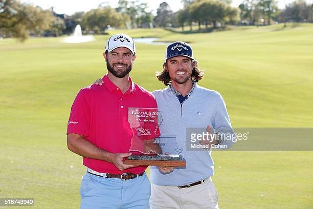 Wesley Bryan holds the trophy as he poses with George Bryan IV his brother and caddie after the final round of the Chitimacha Louisiana Open...