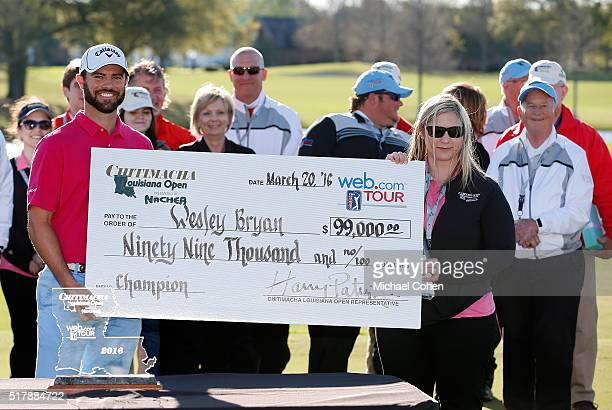 Wesley Bryan holds the winner's check at the trophy presentation ceremony after the final round of the Chitimacha Louisiana Open presented by NACHER...