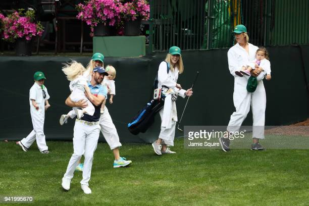 Wesley Bryan of the United States laughs with a guest during the Par 3 Contest prior to the start of the 2018 Masters Tournament at Augusta National...
