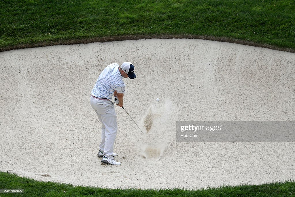 Wesley Bryan plays a shot from a bunker on the ninth hole during the second round of the Quicken Loans National at Congressional Country Club on June 24, 2016 in Bethesda, Maryland.
