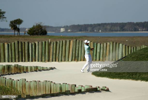 Wesley Bryan plays a shot from a greenside bunker on the 17th hole during the first round of the 2018 RBC Heritage at Harbour Town Golf Links on...