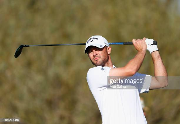 Wesley Bryan watches his tee shot on the sixth hole during the second round of the Waste Management Phoenix Open at TPC Scottsdale on February 2 2018...