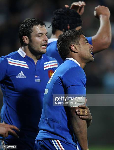 Wesley Fofana and Damien Chouly of France reacts after their loss during the third rugby union match between the New Zealand All Blacks and France at...